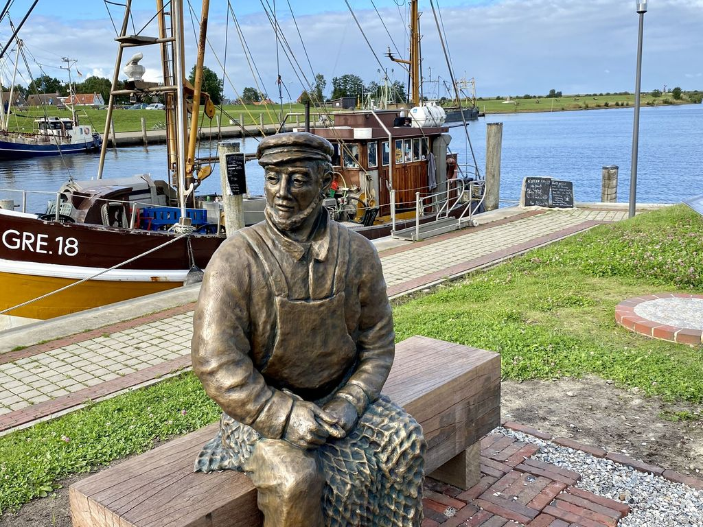 statue of an old fisherman