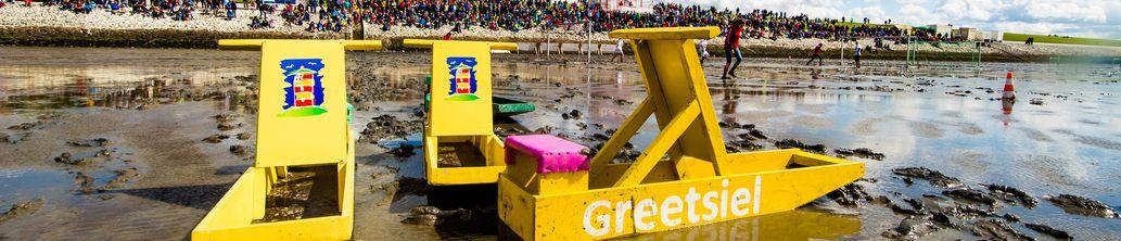 Bild Menü Veranstaltungen Greetsiel Schlickschlittenrennen