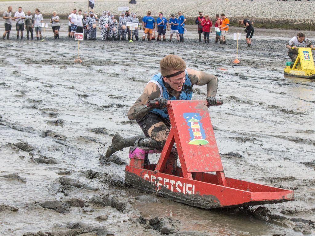 Bild Schlickschlittenrennen Wältmeisterschaft Schlittenfahrer Hero